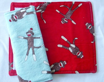 Reversible Car Seat Strap Covers - Tossed Sock Monkeys on Red and Aqua