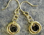 Gold Mobius Love Knot Earrings with Jet Black Crystals