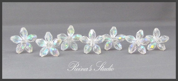 Gorgeous set of Seven Crystal ab Flower Shapped Hair Pins.