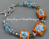 Adorable In Aquamarine and Orange - Bracelet Featuring Handmade Lampwork Glass Beads by The Craftier Side