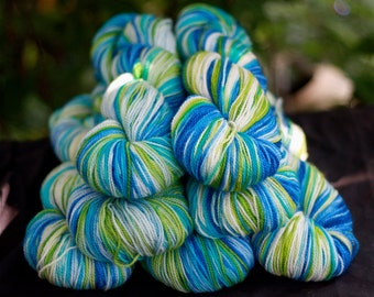 Hand painted Superwash Sock Yarn, 'Splash' colorway, blues, lime green, white