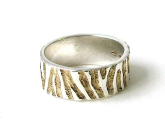 Wide Zebra Ring With Gold Detail.