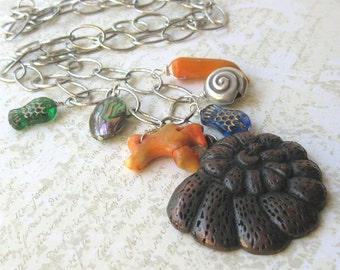 Long chain necklace bronze shell, orange coral and fish embellished. HALF PRICE SALE. Take 50% off.