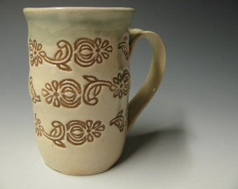 Tan and white patterned mug