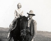 vintage photo real true Cowboy rides lady on Horseback