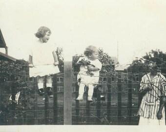 2 Adorable Little Girls Sit on Fence w Roses original vintage photo