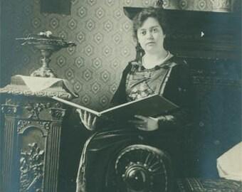 Woman Reading Book or Photo Album 1906 original vintage photo
