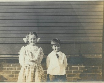1908 little girl check pinafore w brother by house vintage photo