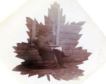 Man Reads Paper on Porch Leaf Pattern Design 1900