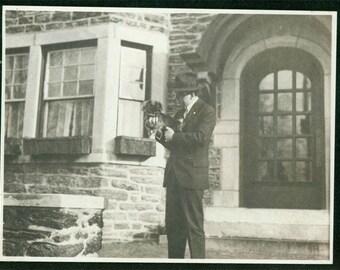 1916 Man holds Chin Chin Pekingese Puppy Dog vintage photo