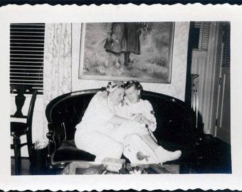 vintage photo best friends Girls Cuddle on COuch 1957