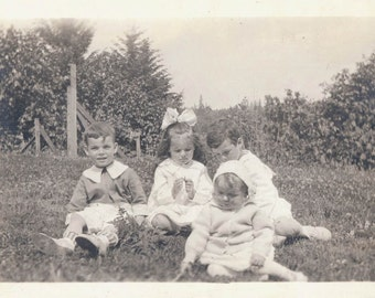 vintage photo Children pick clover relaxing in Summer hillside
