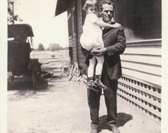 Vintage photo Little Girl held by her Daddy