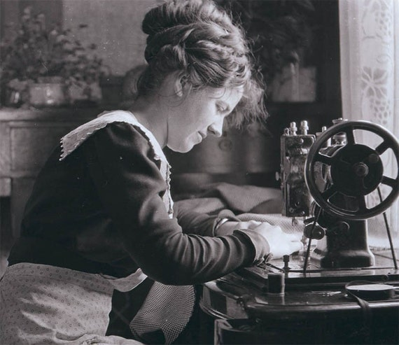 Seamstress at Her Sewing Machine in Window Light