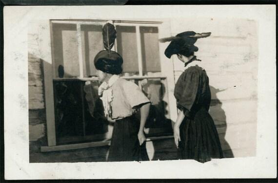 vintage photo 2 women Minnesota log cabin feather hats from back RPPC photo postcard
