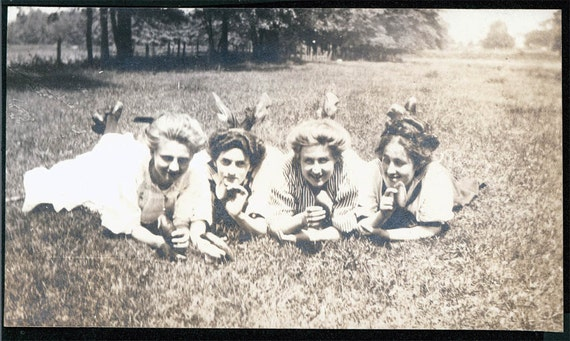 vintage photo Young women Lie in Grass Ea Hold a Leaf