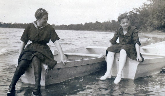 vintage photo Women Sailor Swimsuits Sit on Boats at Waters Edge