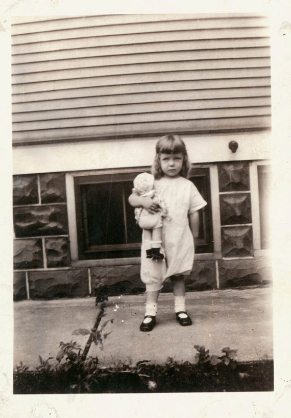vintage photo Girl Holds her DOll wearing a Jumpsiit w Bloomers so sweet