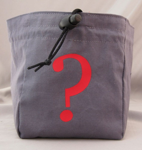 Specialty dice bag with red vinyl question mark and red batik