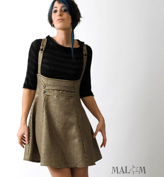 high waisted jumper skirt with suspenders black and gold