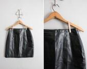 final sale item / 1980s vintage black leather mini skirt