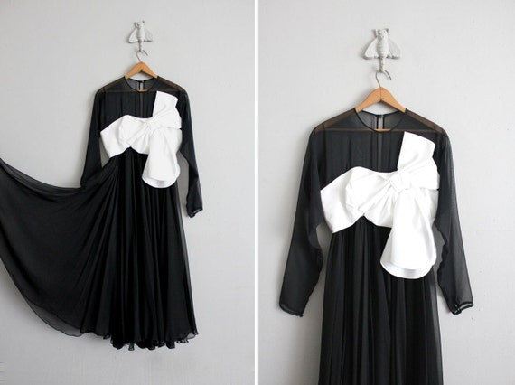on hold / 1970s vintage black and white chiffon party dress