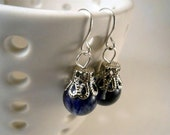 Queen of Tarts silver EARRINGS with blueberry quartz stones wearing tall crowns