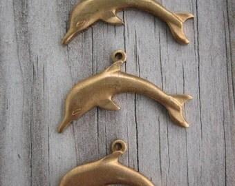 Three Raw Brass Dolphins