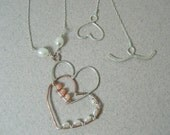 Hammered overlapping beaded sterling silver and copper heart dangle