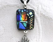 Dichroic glass pendant with hand charm