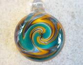Turquoise and Rasta Gold Spiral Switchback Boro Pendant