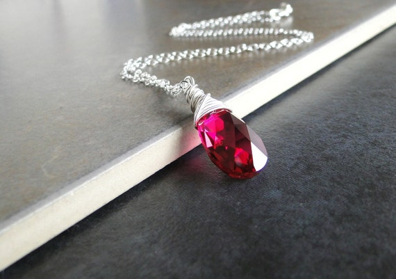 Ruby Red Swarovski Crystal Wire Wrapped Necklace On A Sterling Silver Chain.