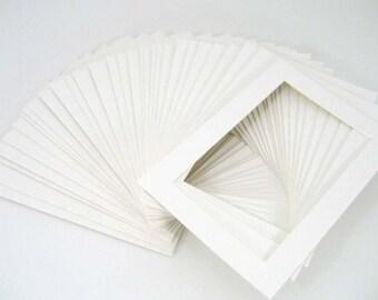 10 8x10 white mats for 5x7 photos or artwork