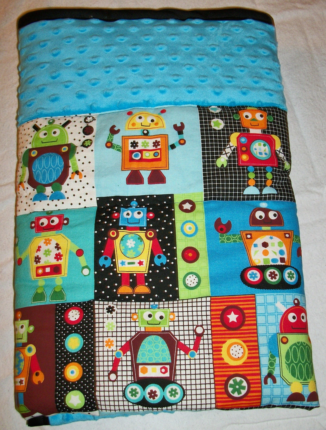 super cute and fun robot baby quilt with blue dot minky fabric