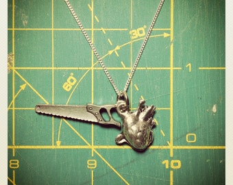 Saw and Heart Pewter Charm Necklace with Anatomical Heart Charm and Sterling Silver Chain