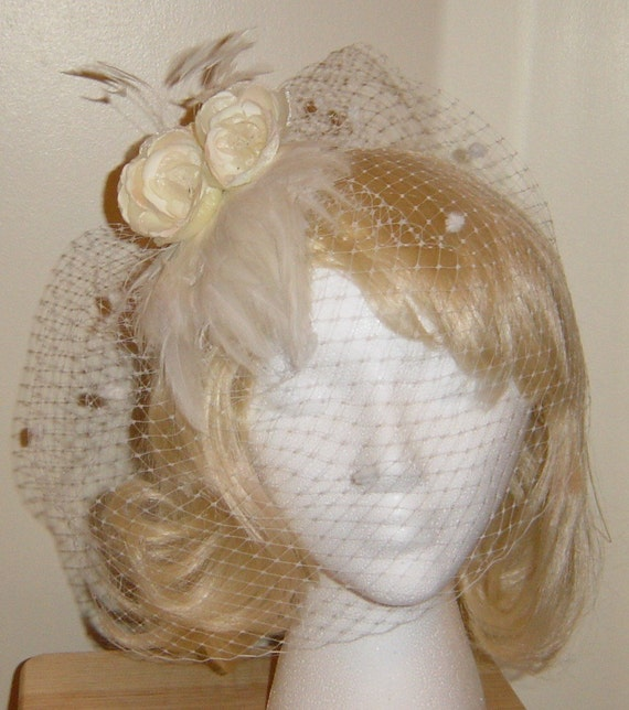 Birdcage veil bridal headpiece feather fascinator