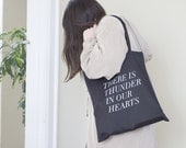 thunder in our hearts tote in black