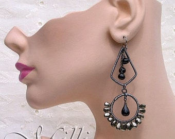 Art jewelry earrings of sterling silver wrapped frames with Black Garnet and faceted Pyrite briolettes