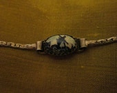 Amazingly detailed silver toned metal bracelet with tiny cabochon faux Delftware painting windmill