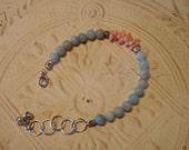 Bluish-green jade and peach coral bracelet