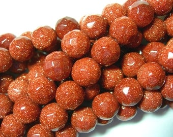 SPARKLE Goldstone 10mm faceted beads - 16inch strand