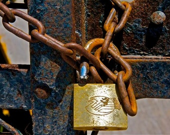Photograph rust gold blue chain and lock rusty chain gold lock rusted blue gate wall decor Greece Greek