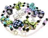 Neon Lights -  Artisan Lampwork Purple, Blue, Lime and Black Bead Necklace with Swarovski Crystals and Butterfly Pendant ..... SRAJD 1373