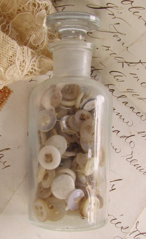 Vintage Glass Bottle with lid...125 white buttons