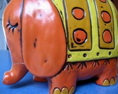 vintage orange elephant bank imported from Japan by Pride Creation