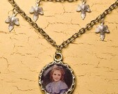 Necklace with child portrait and maple leafs