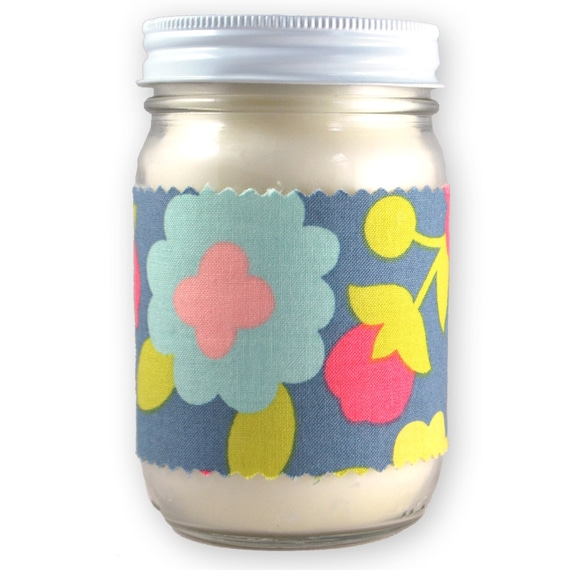 clean cotton scented soy wax candle - grey with bright colored floral printed fabric accent