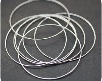 Tinkling Stack of  Sterling Silver Bangles - Set of 7