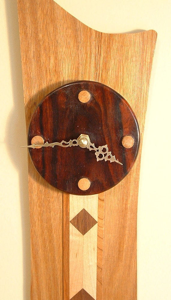 Wall clock handcrafted from solid,highly figured exotic hardwood,battery electric,free shipping