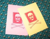 skull and bones stamp postcard gocco